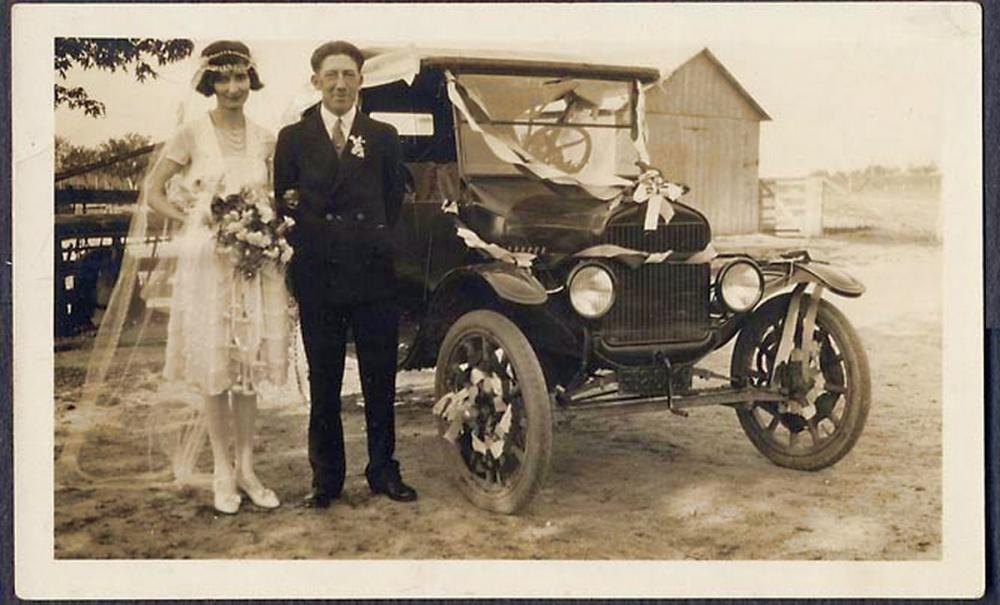 Wedding Couple Posing With The Wedding Ride.JPG