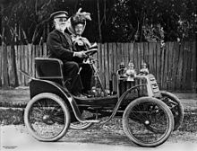 220px-StateLibQld_1_95492_Out_driving_in_an_early_Linon_motor_car_in_Ipswich.jpg